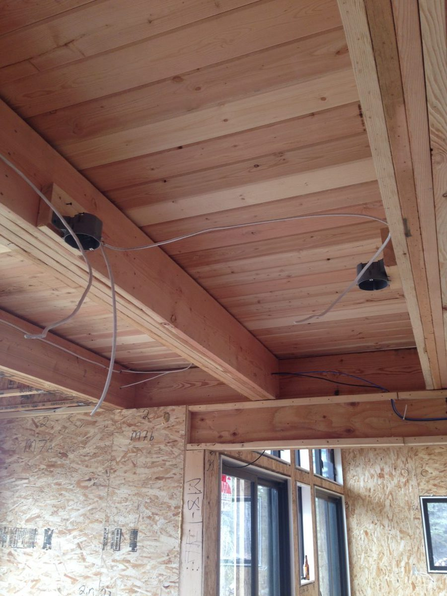 Fir tongue-and-groove floor for the loft creates an interesting ceiling from the kitchen and dining rooms.